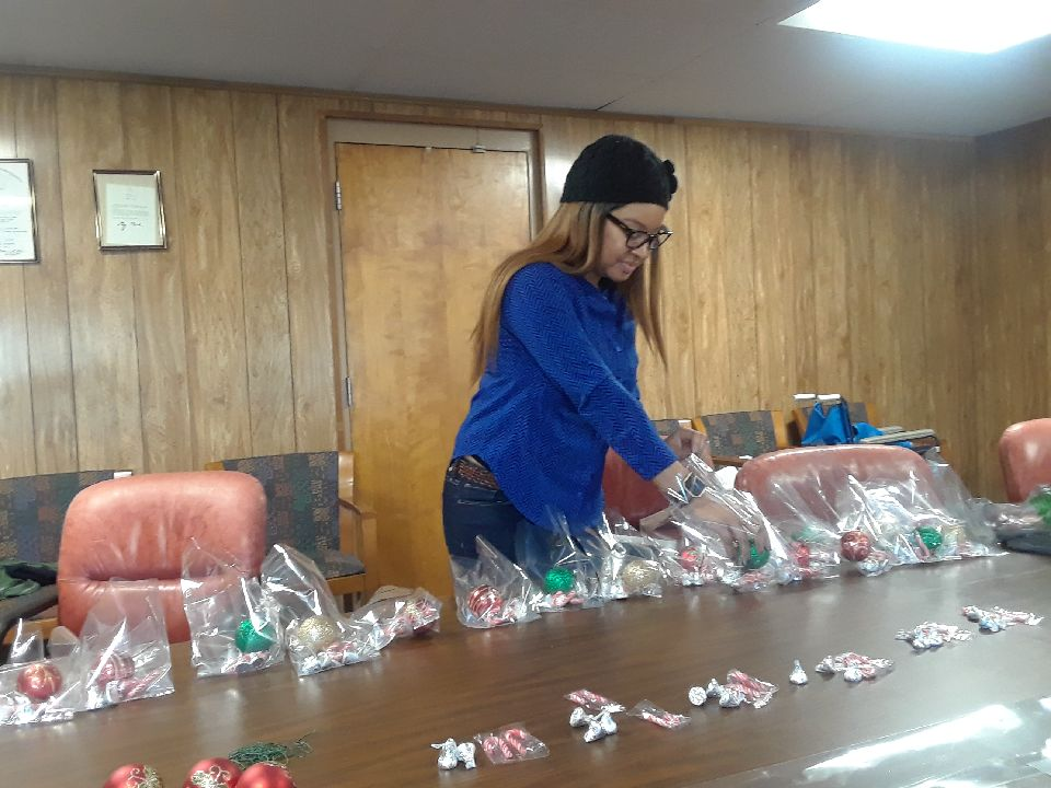 First Lady Portsha Franklin-Gordon assembling treats for the St. John Missionary Baptist Church Ministry at the Italian Home in Jamaica Plain