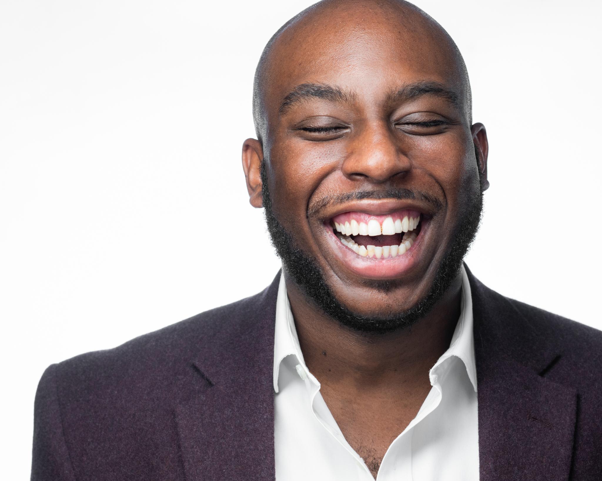 male laughing headshot