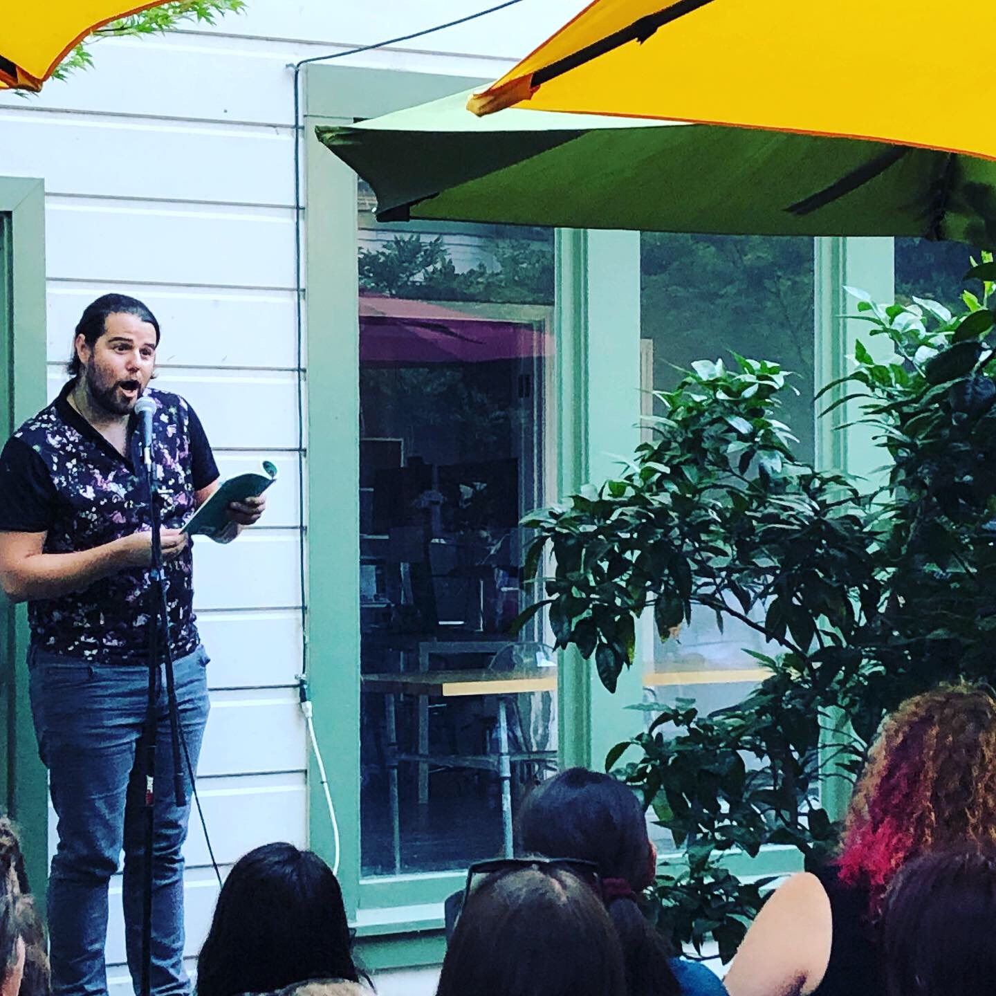 Matty reads at the Cultural Crawl Poetry Reading sponsored by Ecotone at ASLE 2019. Photo courtesy Amanda Hawkins.