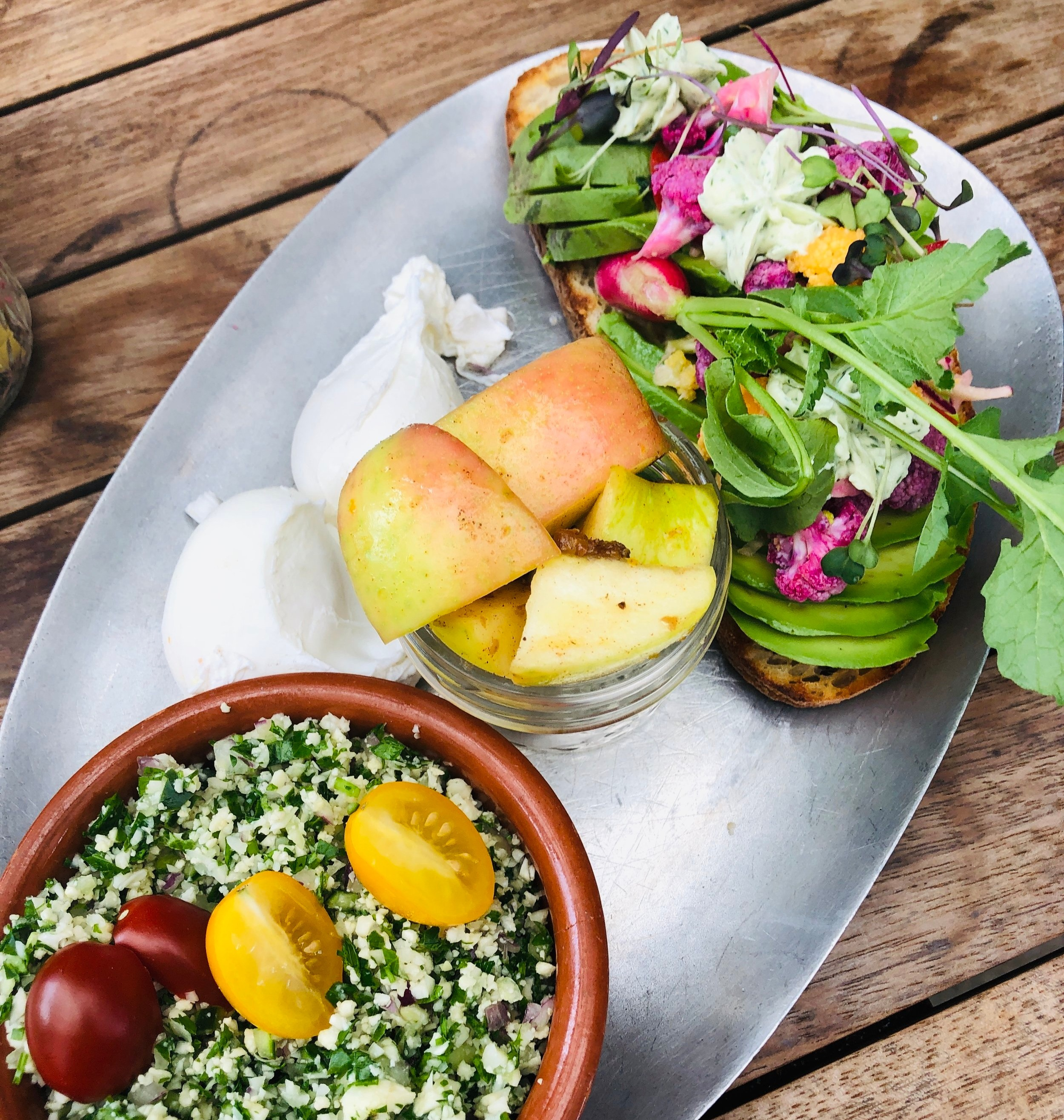 Seasonal avocado toast, poached eggs, seasonal fruit and cauliflower tabouleh at    The Kitchen at the Dunlavy.