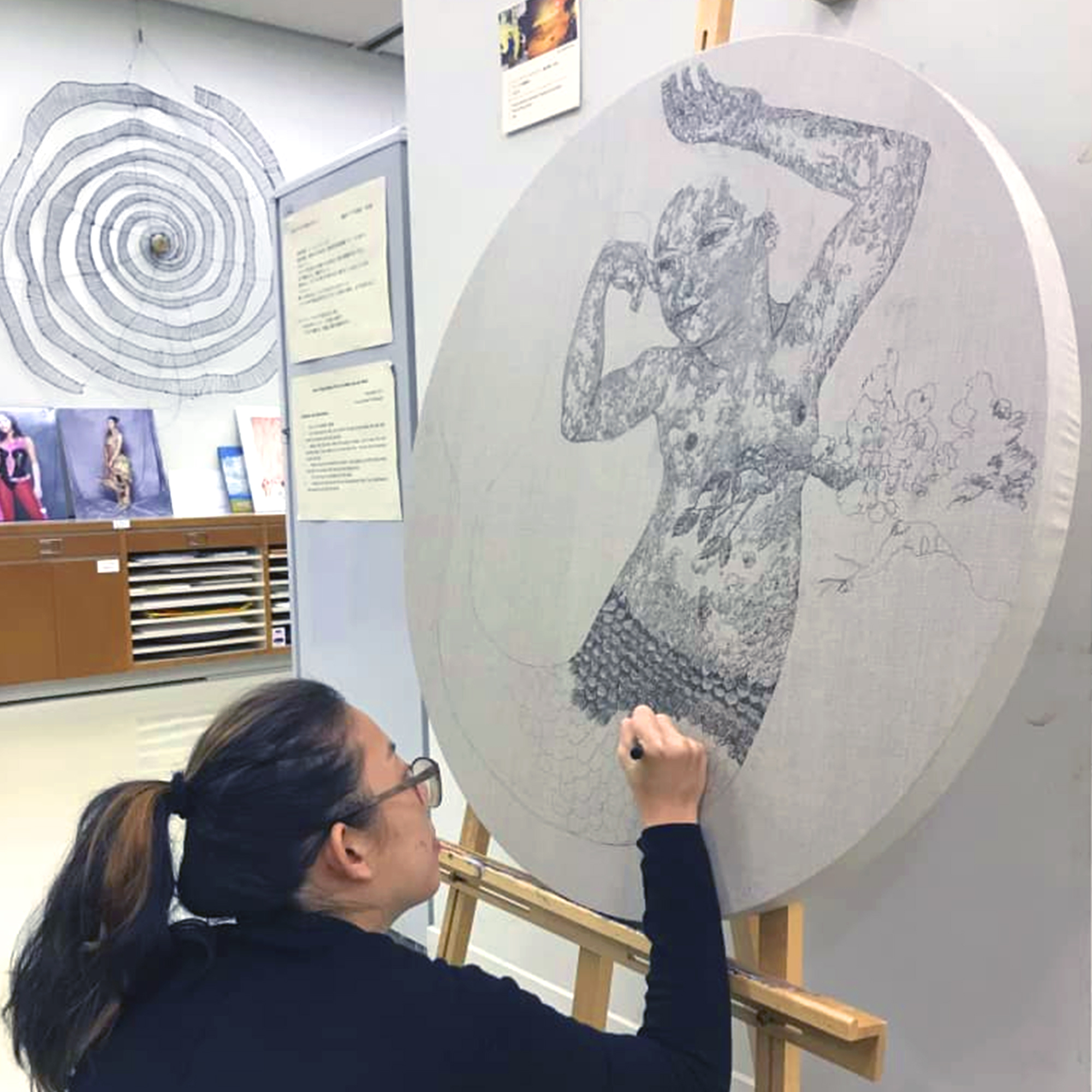 Ms Cheong Kiet Cheng, winner of the 2018 UOB Painting of the Year (Malaysia) Competition and 2018 UOB-Fukuoka Asian Art Museum's (FAAM) Artists Residency Programme completing an artwork during her residency programme at the FAAM, Japan.  Source:  UOB