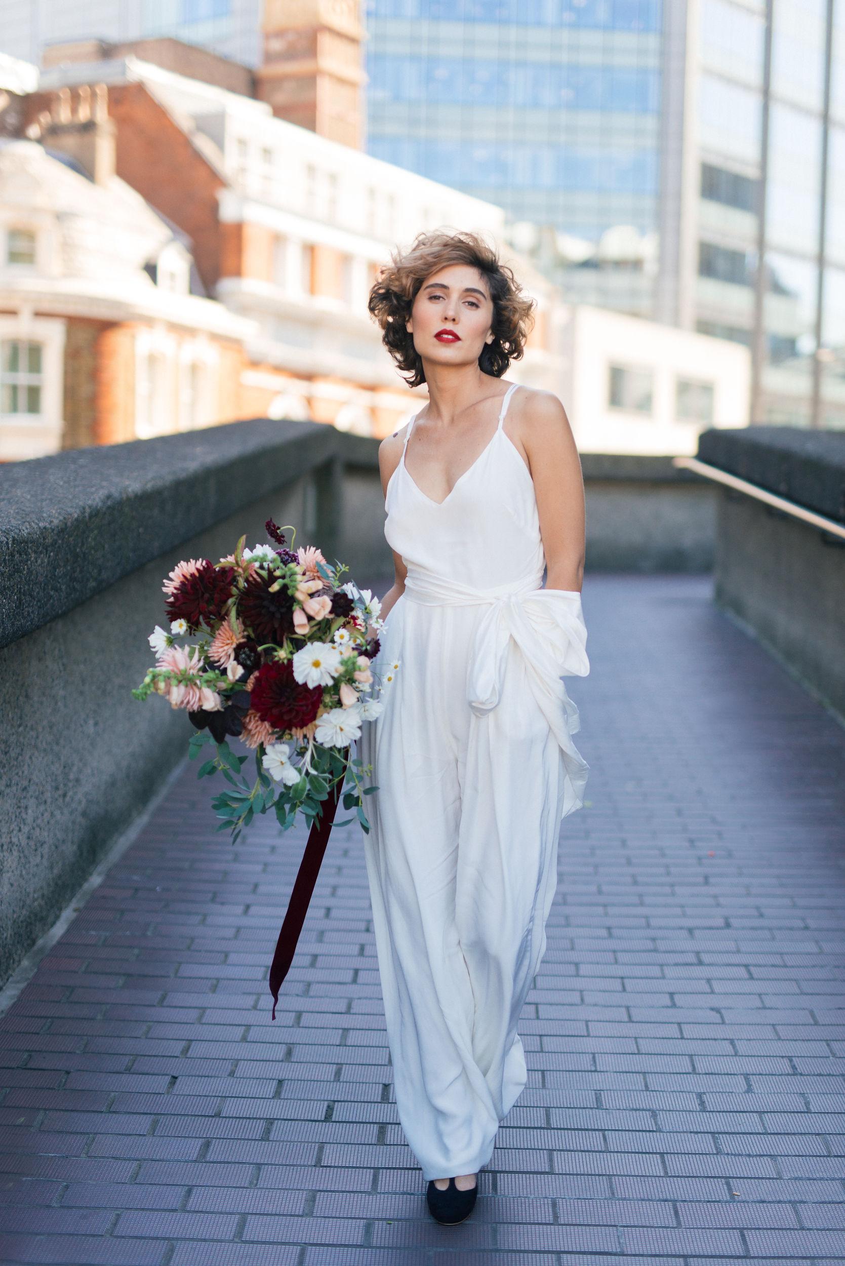 Photographer - Sussie Mellstedt  Model - Clementine Bourdin  Jumpsuit - Heart Aflutter Bridal  Flowers - Dove And Myrtle