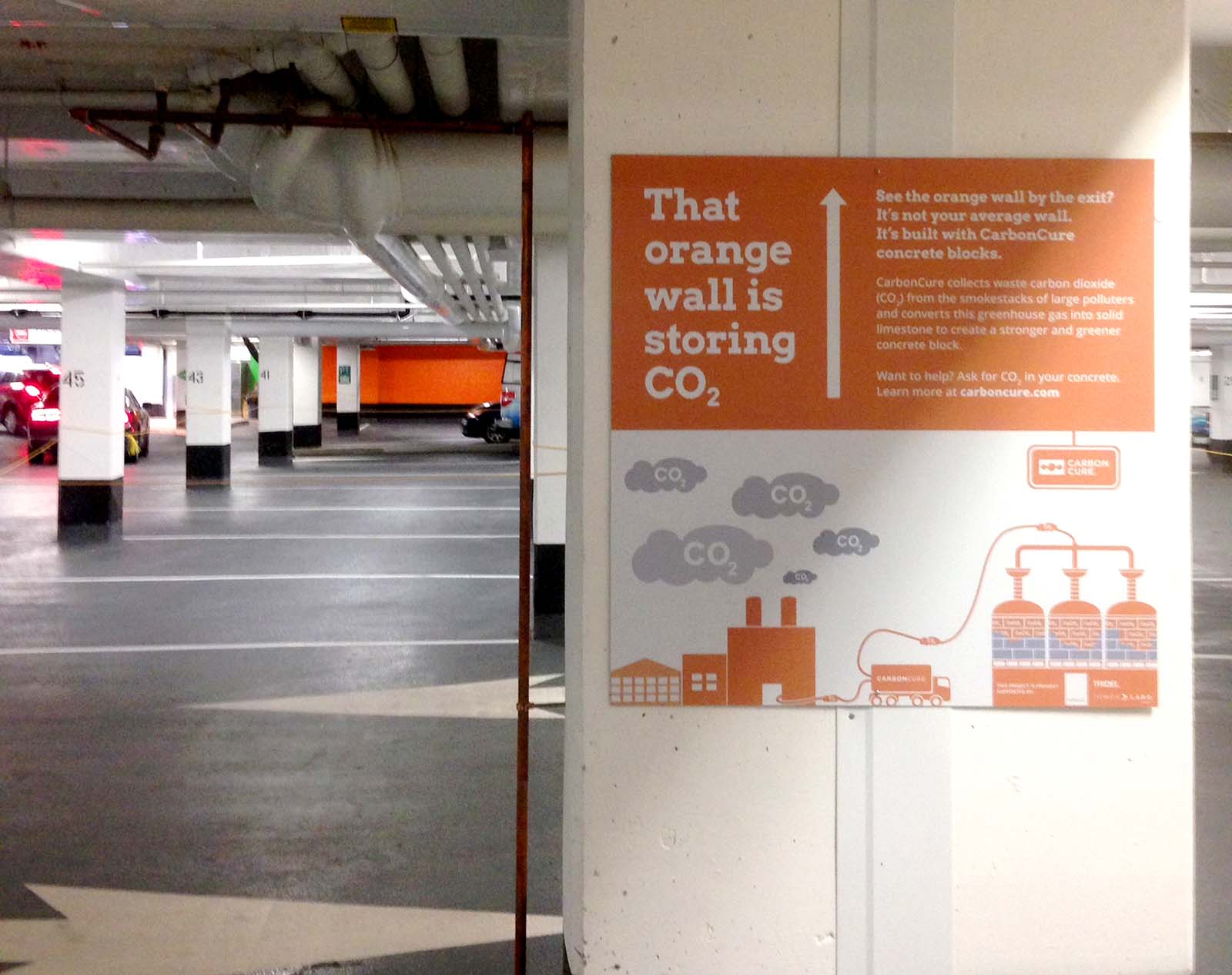Developer Tridel showcased its building's carbon reduction using signs throughout its concrete parking garage.
