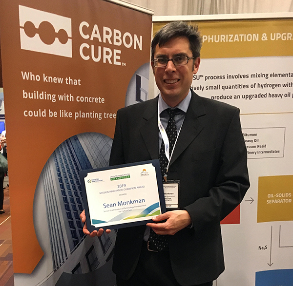 Dr. Sean Monkman with his Mission Innovation Champion award at the awards ceremony in Vancouver.