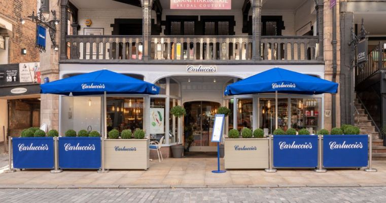 People watching in bridge st at carluccios