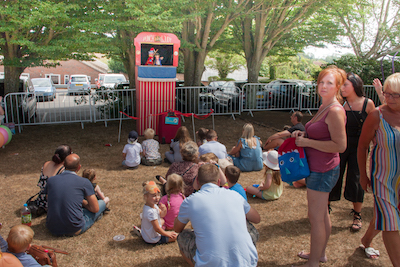 Children enjoying the Punch and Judy show
