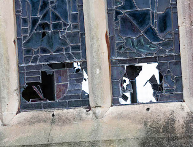 The smashed windows at St Peter's Church