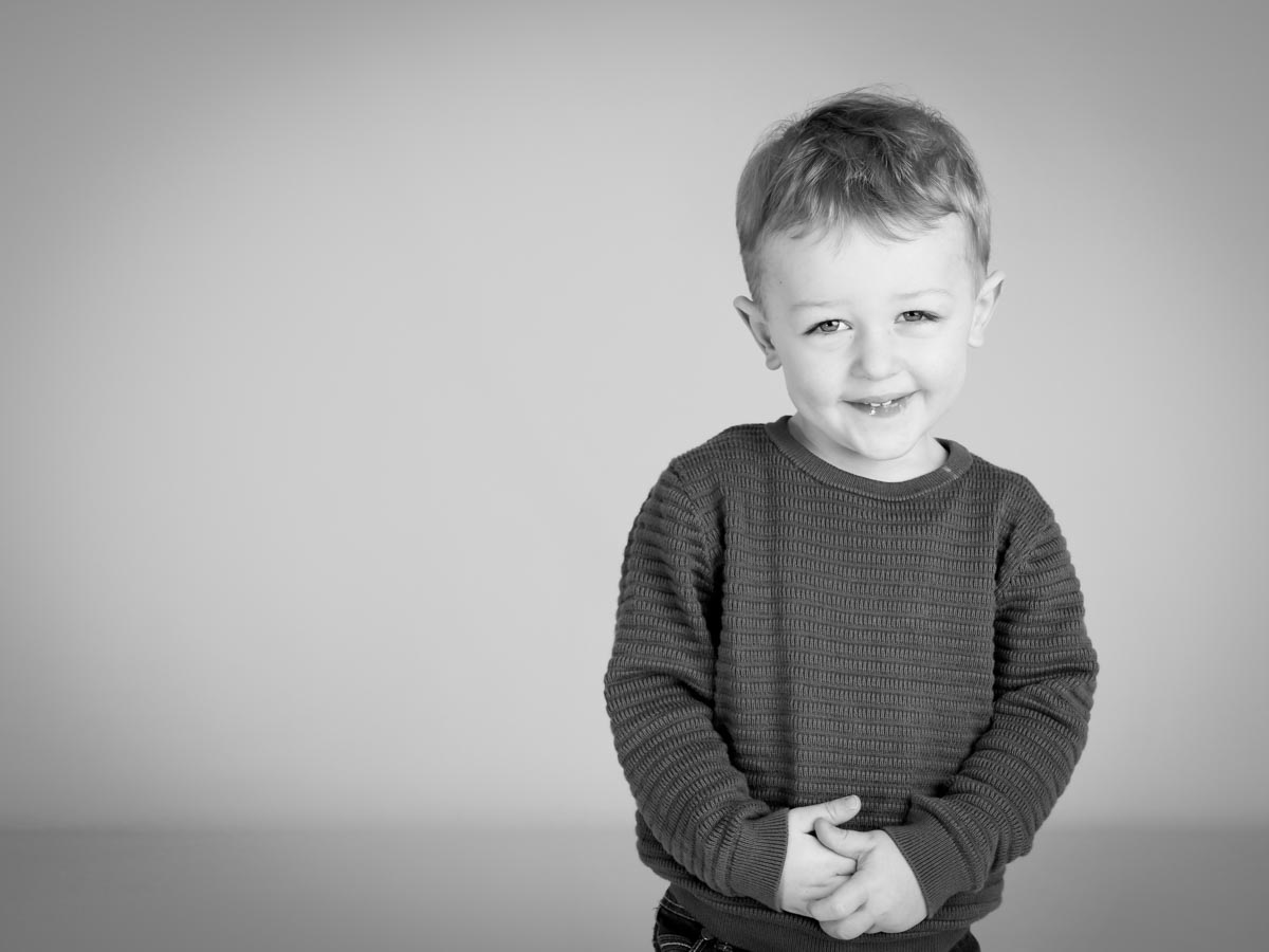 A shy boy during portrait photography