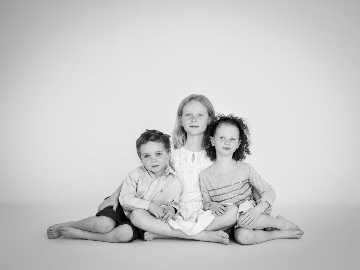 Three siblings in a traditional portrait photography session