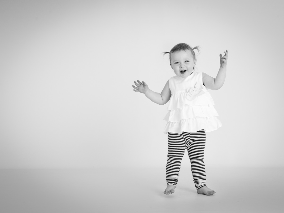 Copy of Toddler excited at her family photoshoot