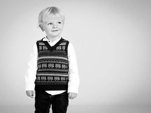 Little boy portrait with untucked shirt
