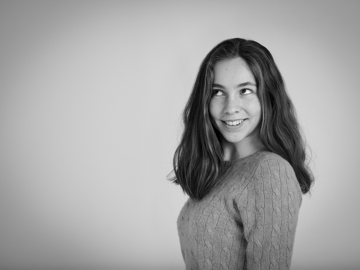 Teenage girl smiling for her portrait