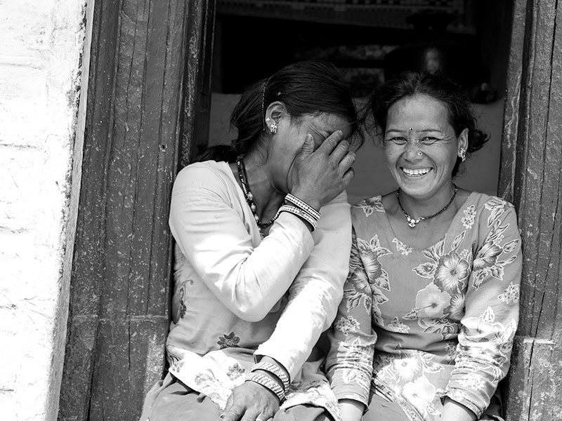 Asking these ladies to sit in the shady doorway to their house meant I could take some natural photographs and test out my terrible Hindi on them.