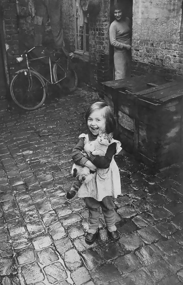 Portrait of little girl with her cat
