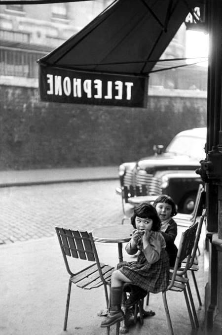 Children outside a cafe black and white