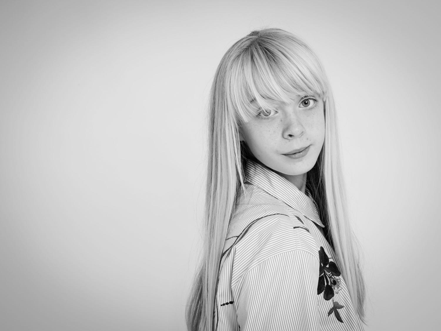 Girl with blonde fringe