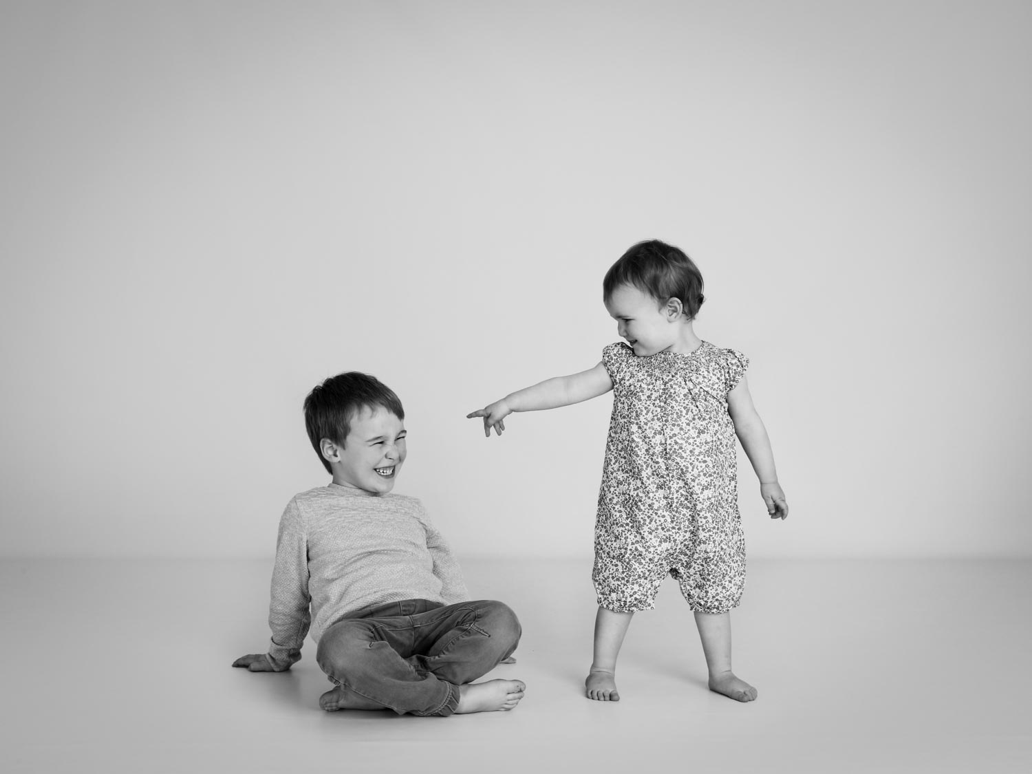 Little girl pointing in the studio