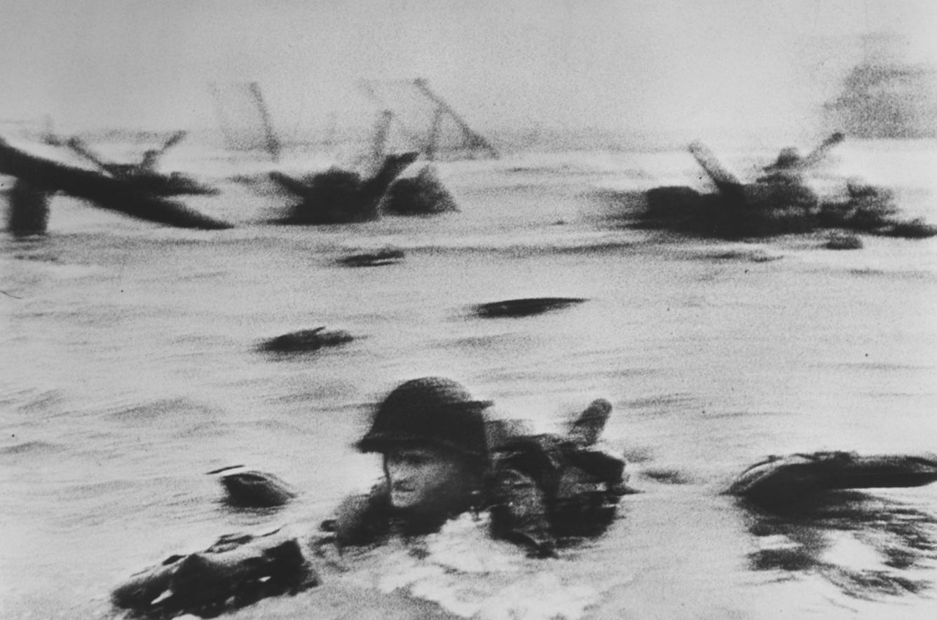 Normandy. June 6th, 1944. American troops landing on Omaha Beach, D-Day. Robert Capa © International Center of Photography