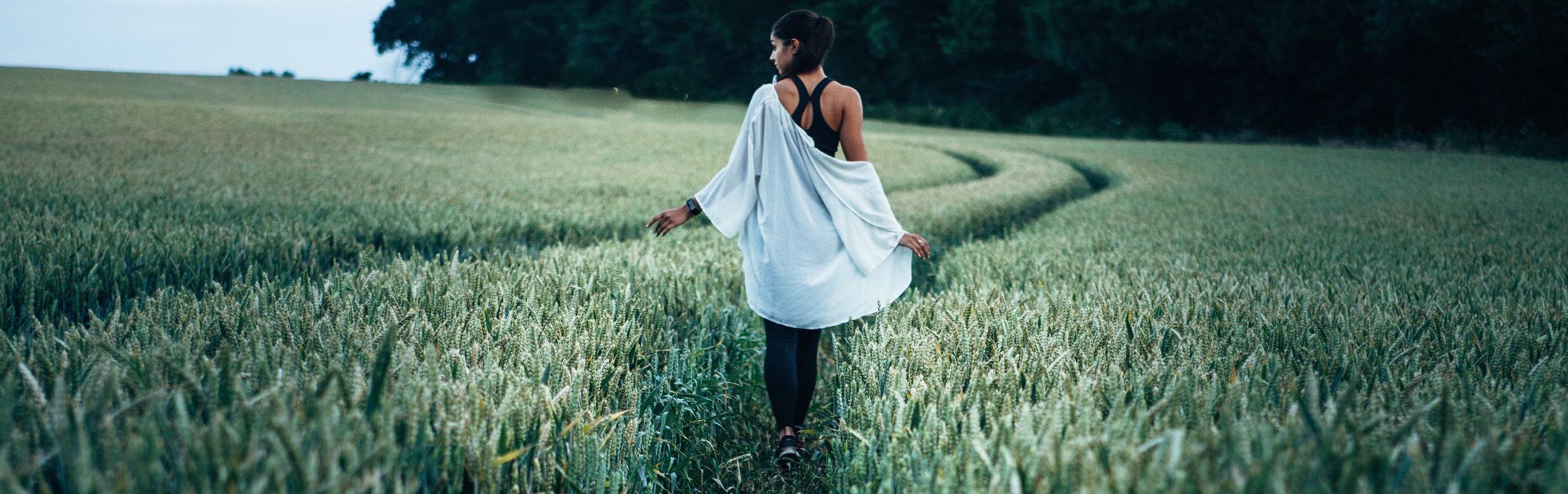 girl in field on path.jpg