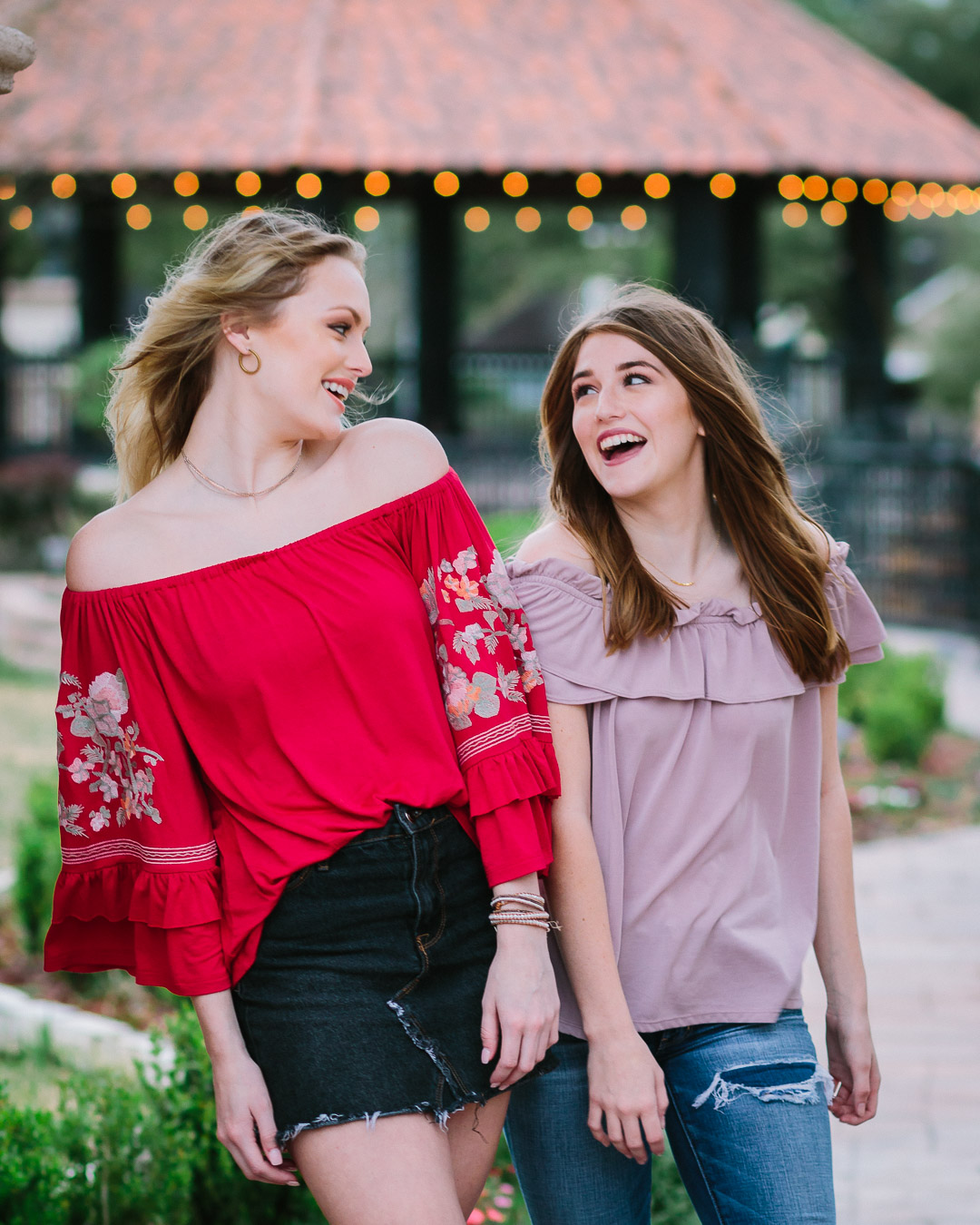 Two senior girls laughing in candid photo