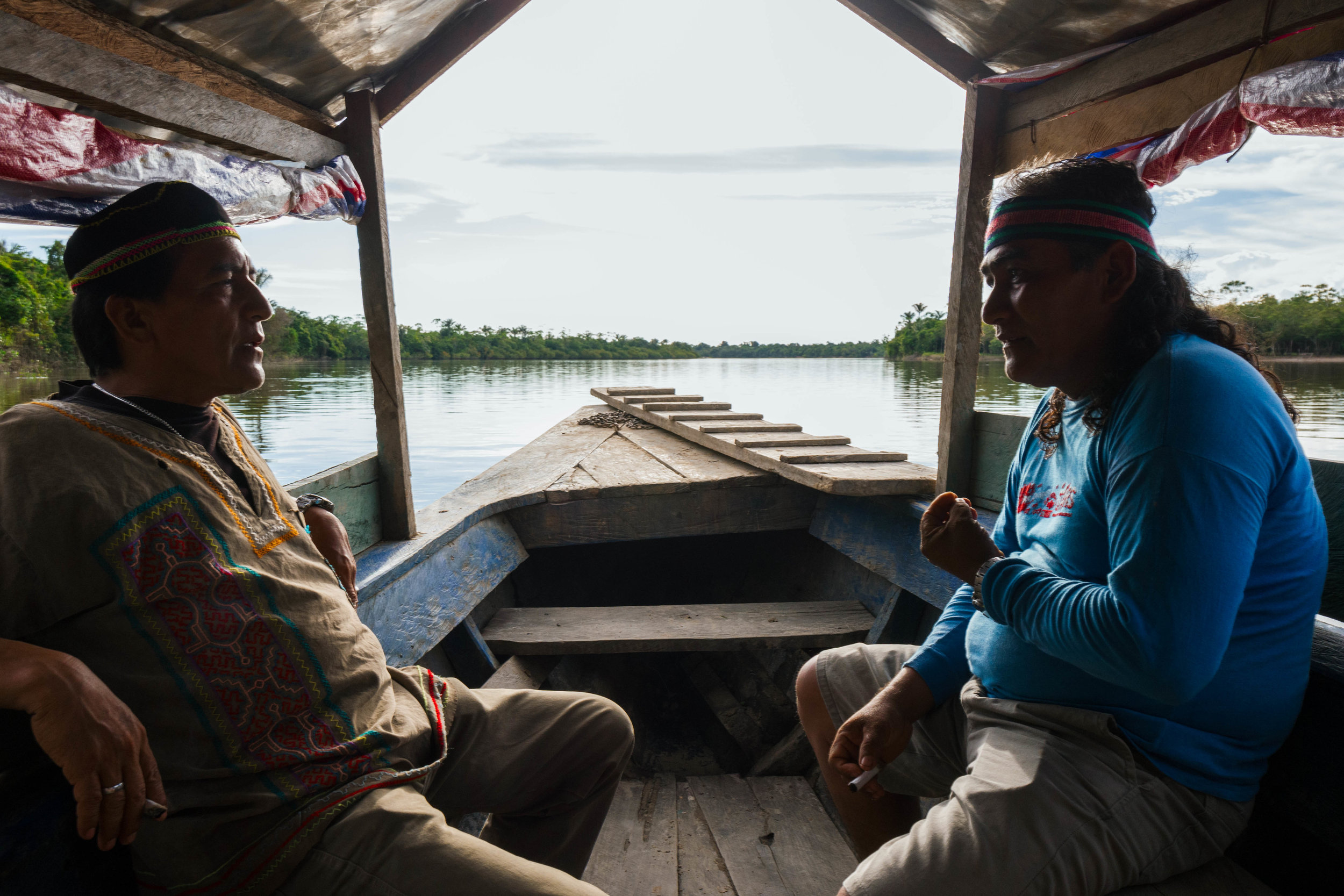 SHAMAN MAGNO ZAMBRANO PANDURO, RIGHT, AND HIS BROTHER TRAVELING ON THE AMAZON RIVER. CREDIT: LURE