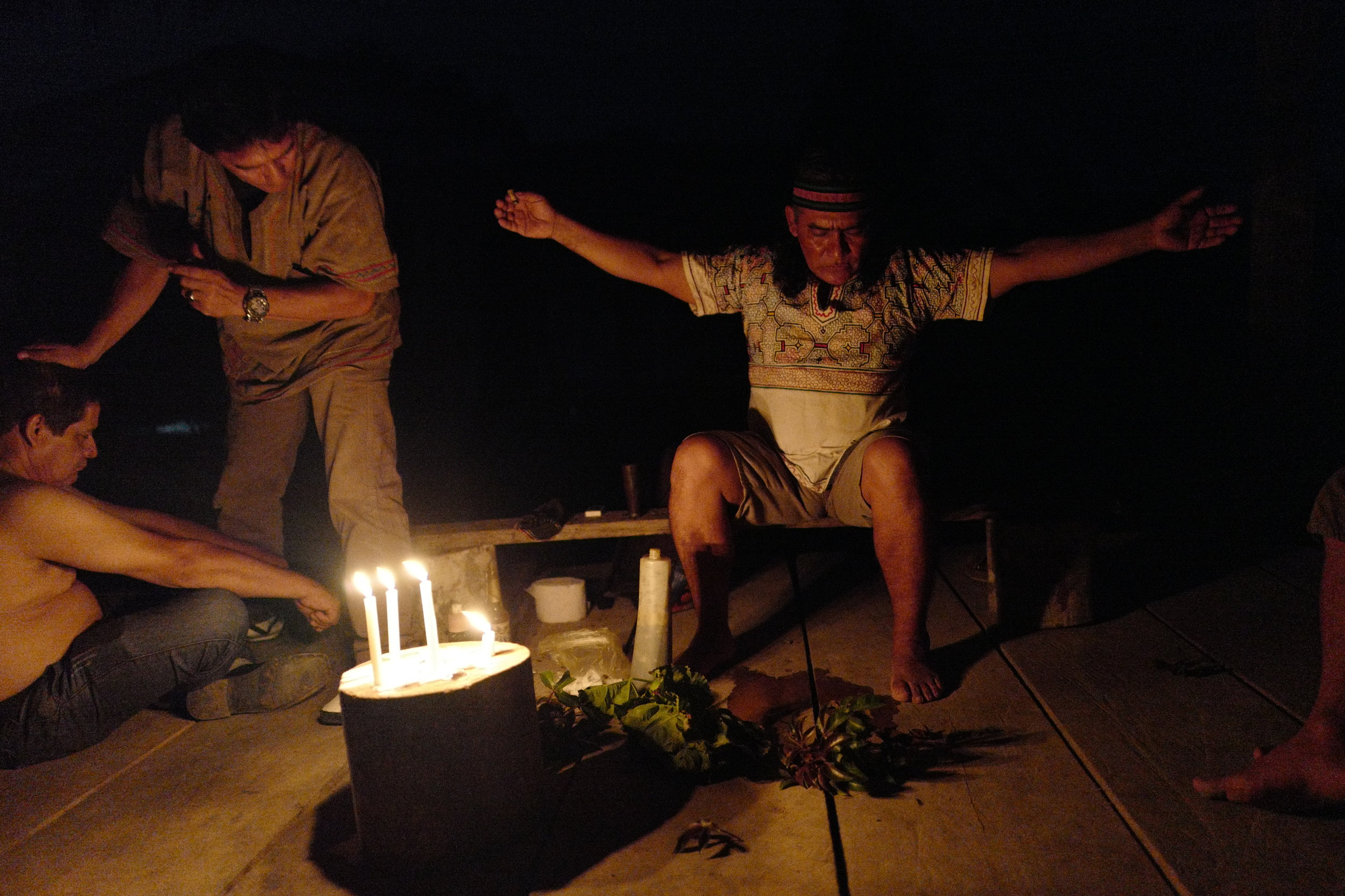 SHAMAN MAGNO ZAMBRANO PANDURO LEADS AN AYAHUASCA CEREMONY IN THE AMAZON. CREDIT: LURE