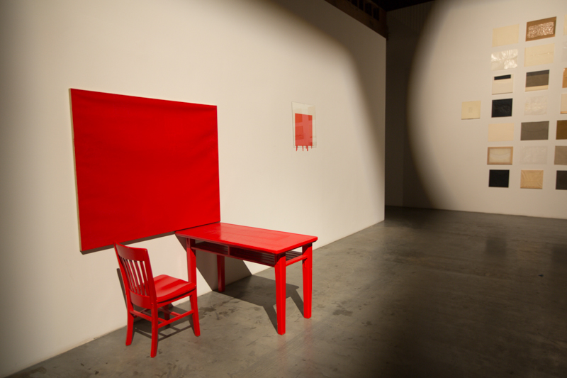 Cadmium-Vermillion (Barium) Red, Medium – Studio; table, chair, oil on canvas, oil painting on wall with resin on glass overlay; dimensions variable