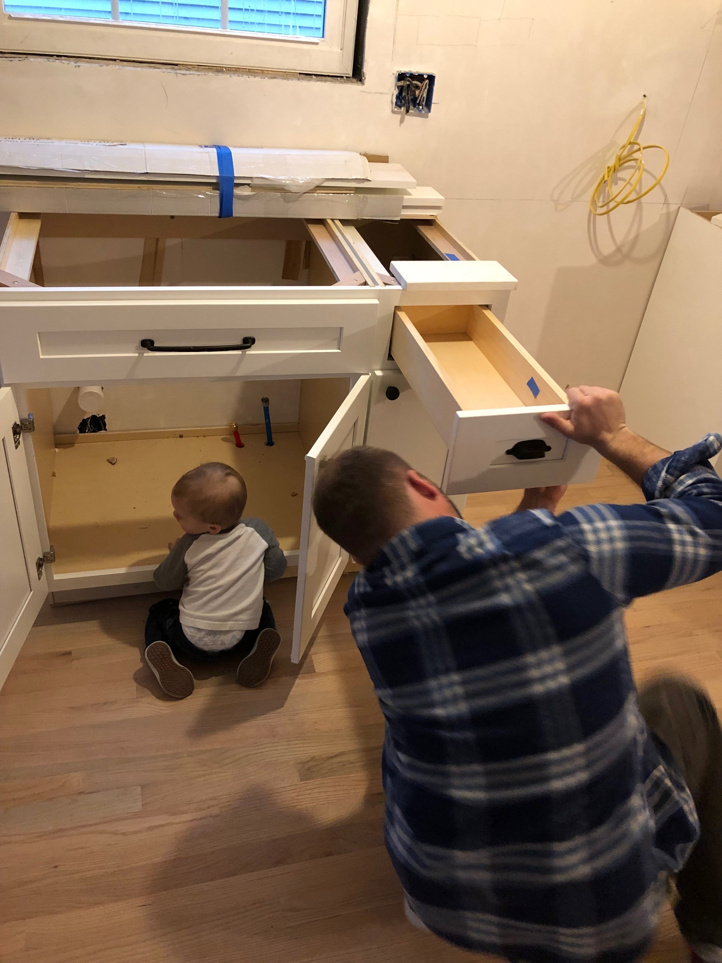 One of our apprentices learning how to adjust cabinet doors and drawers