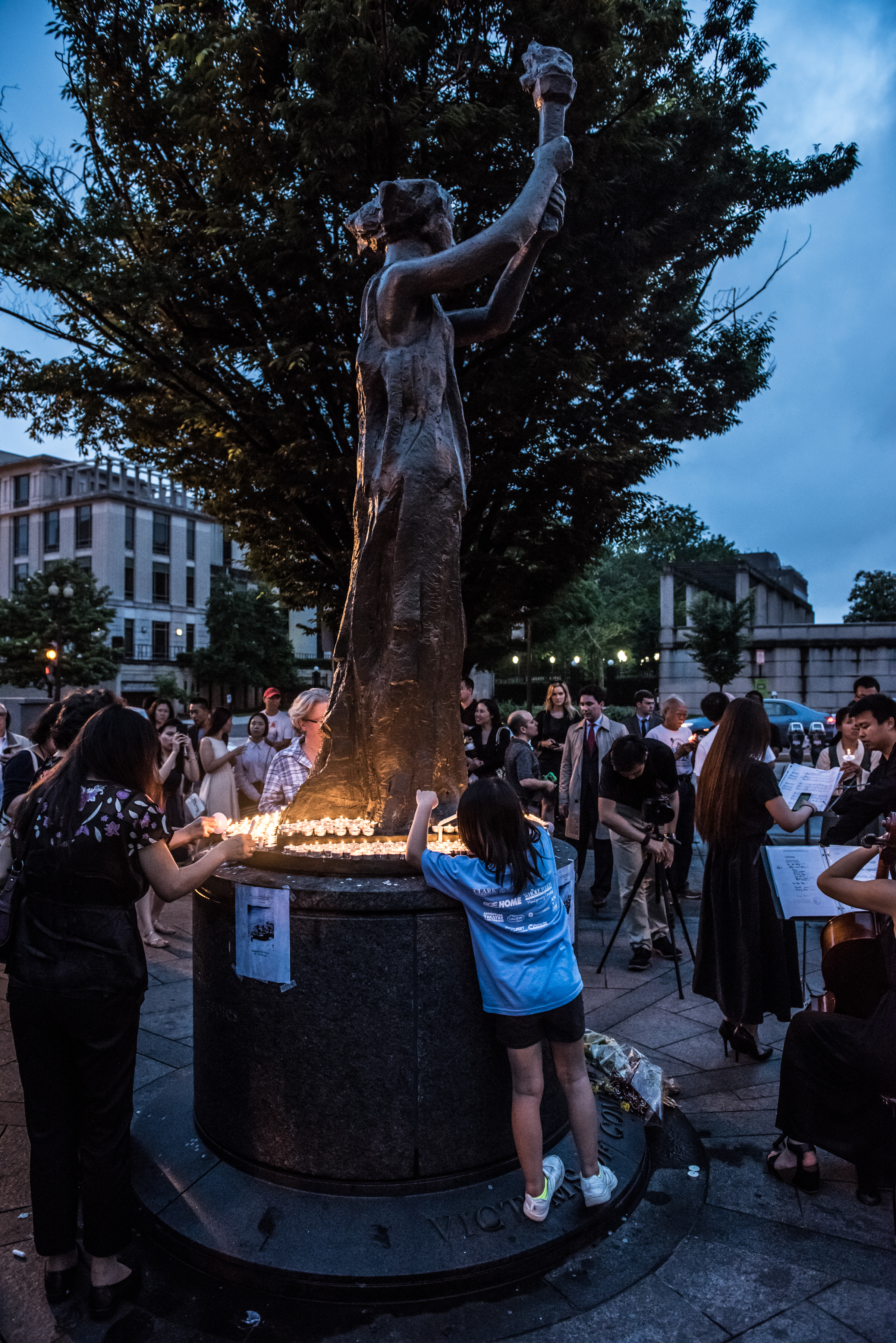 Dissidents, family, and friends gather at the Victims of Communism Memorial in Washington, D.C. for a vigil commemorating the Tiananmen Square Massacre.