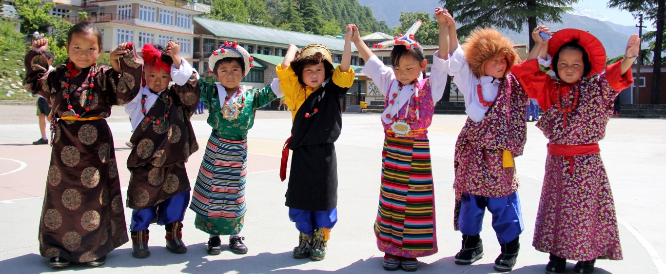 Children wear traditional Tibetan dress at the Tibetan Children's Village in Dharamsala, India