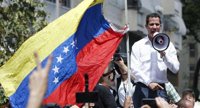 Juan Guaido, who declared himself Venezuela's interim president, speaks to supporters during a rally against the government of President Nicolas Maduro, in Caracas, Venezuela, Saturday, March 9, 2019. (AP Photo/Eduardo Verdugo)