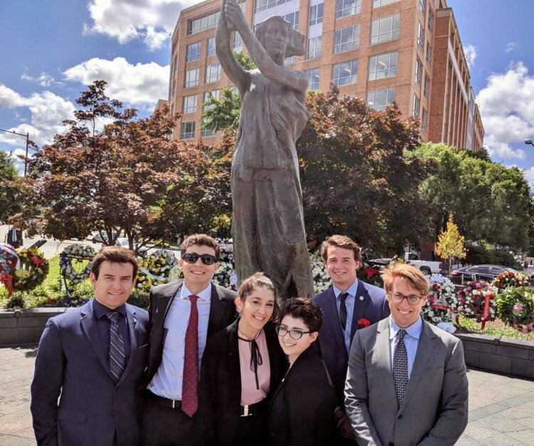Our Interns gathered around the Victims of Communism Memorial at the 12th Annual Roll Call of Nations Wreath Laying Ceremony & Truman-Reagan Medal of Freedom Presentation.