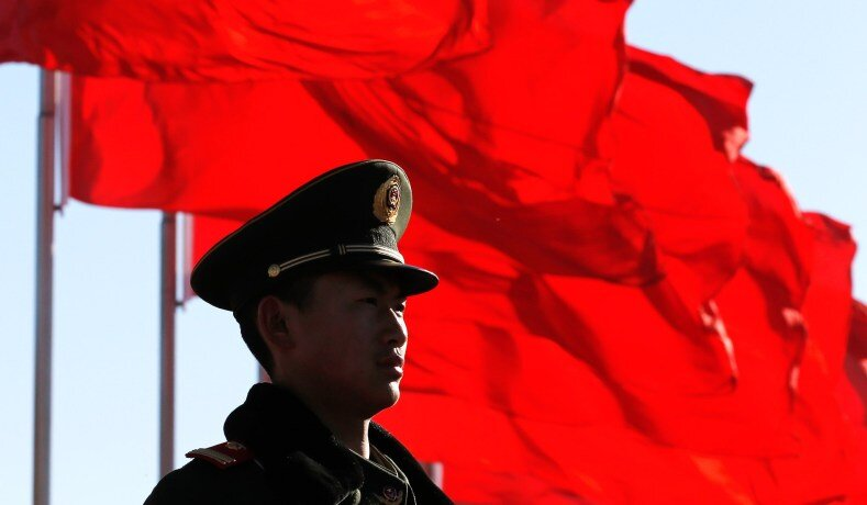 A paramilitary policeman stands guard at Tiananmen Square in Beijing, China, in 2013. (Kim Kyung-Hoon/Reuters)