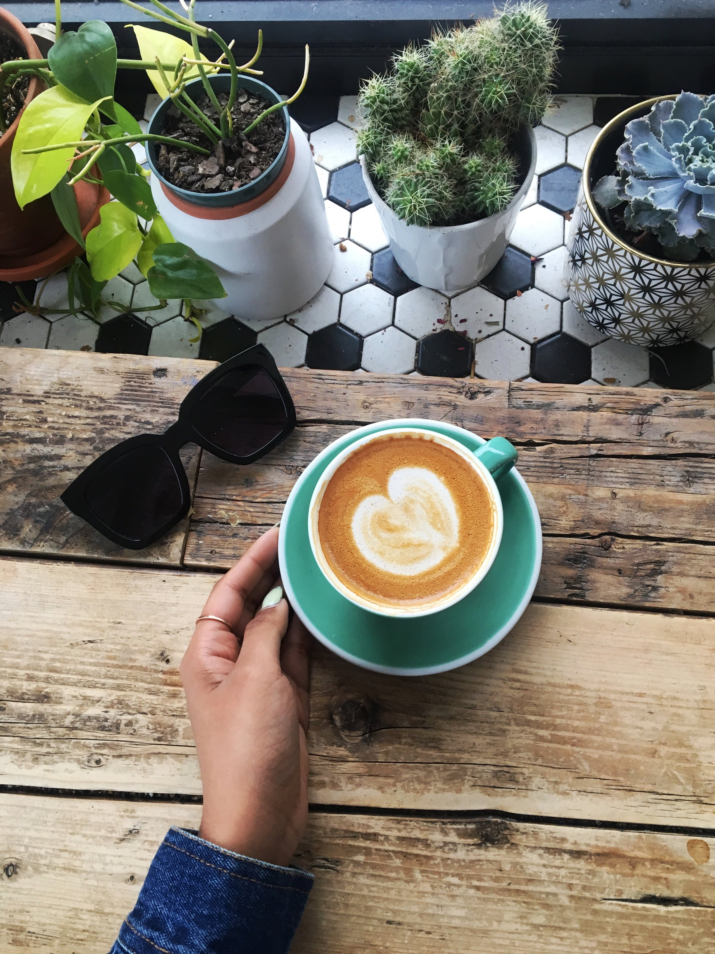 Flat white with almond milk + greenery for the perfect vibe.