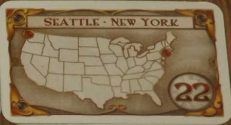 For example, this Destination Ticket, if held by a player, will require them to place trains of their own color such that Seattle and New York City are connected somehow. If this is done, the player receives 22 points at the end of the game; otherwise, they lose 22 points.