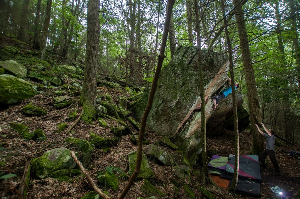 The author climbing the  Petrified  boulder in Upper Middle Creek. Photo by Micah Gentry.