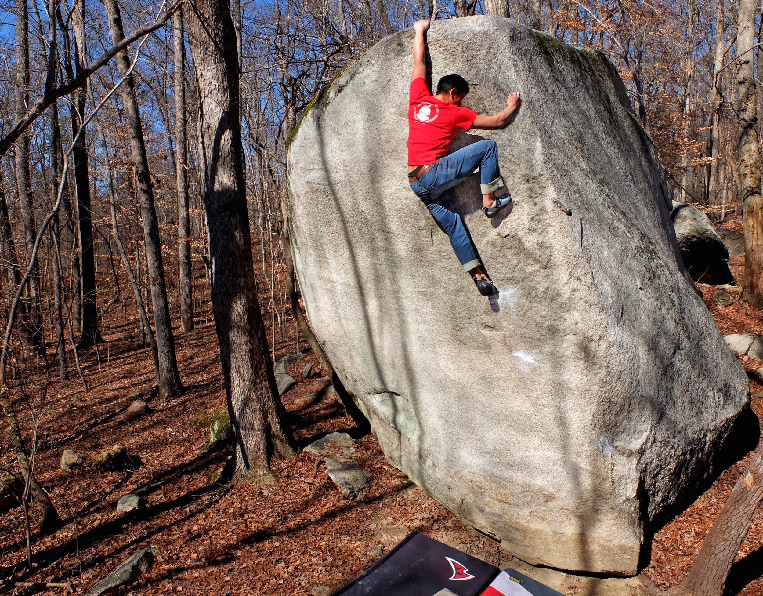 Nick Yan climbing  Yellow Arete  at Boat Rock. Photo by Elaine Elliott.