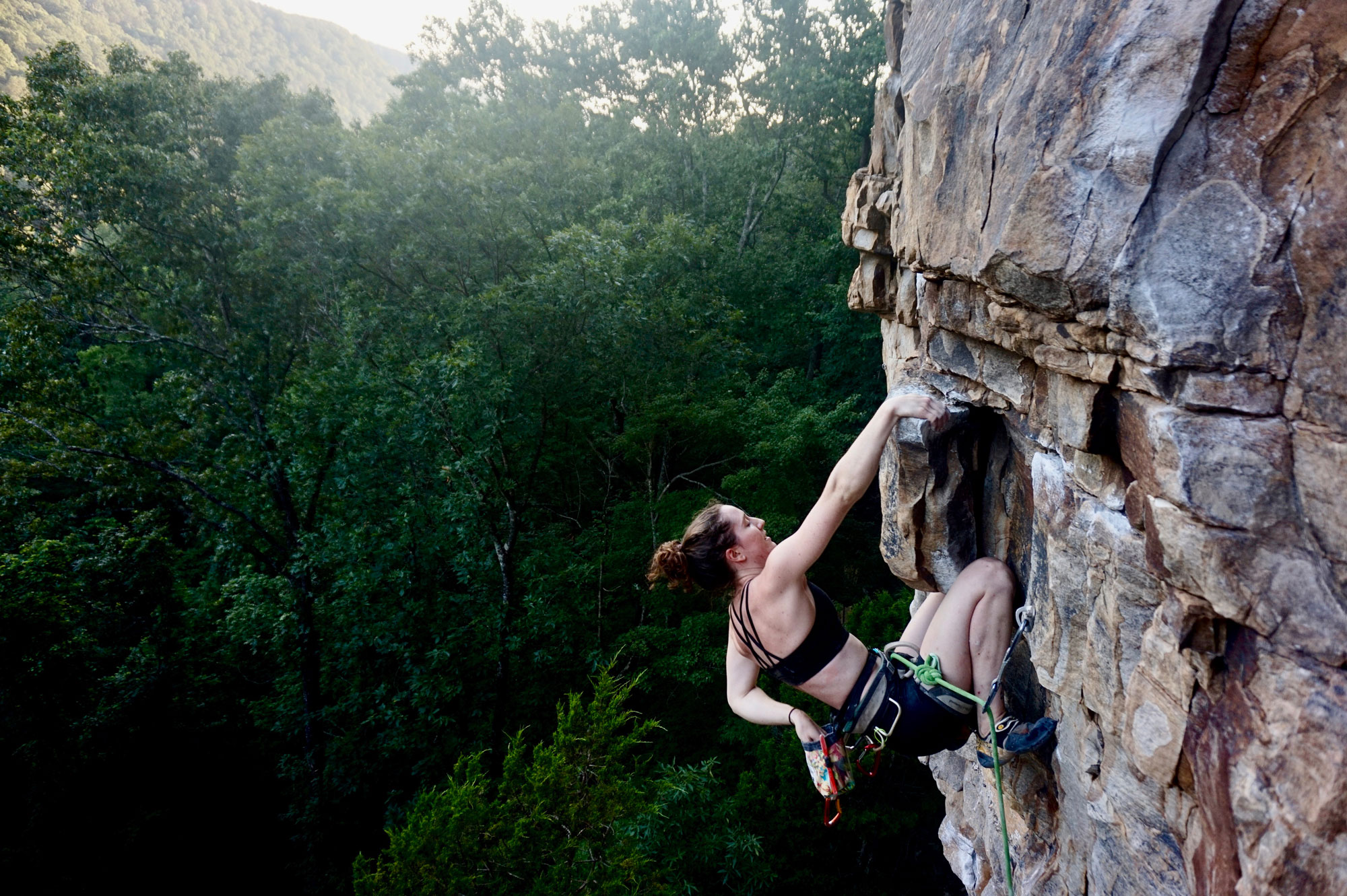 The author resting on one of many knee bars at the crag. Photo courtesy of  Sarah Anne Perry .