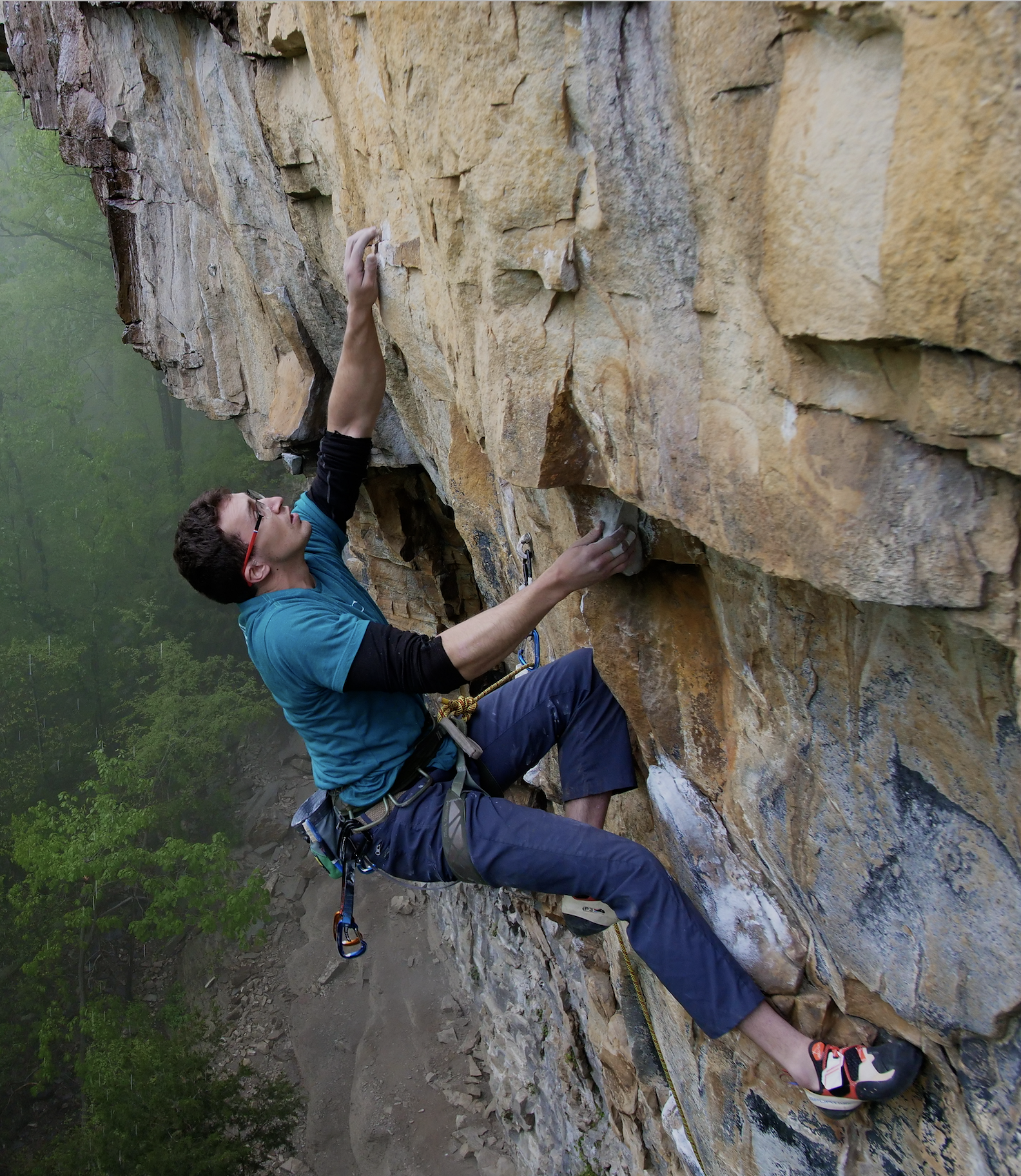 Justin Jakimiak climbing Mutatious (5.12c) on a rainy day. Photo by  Rich Moore .