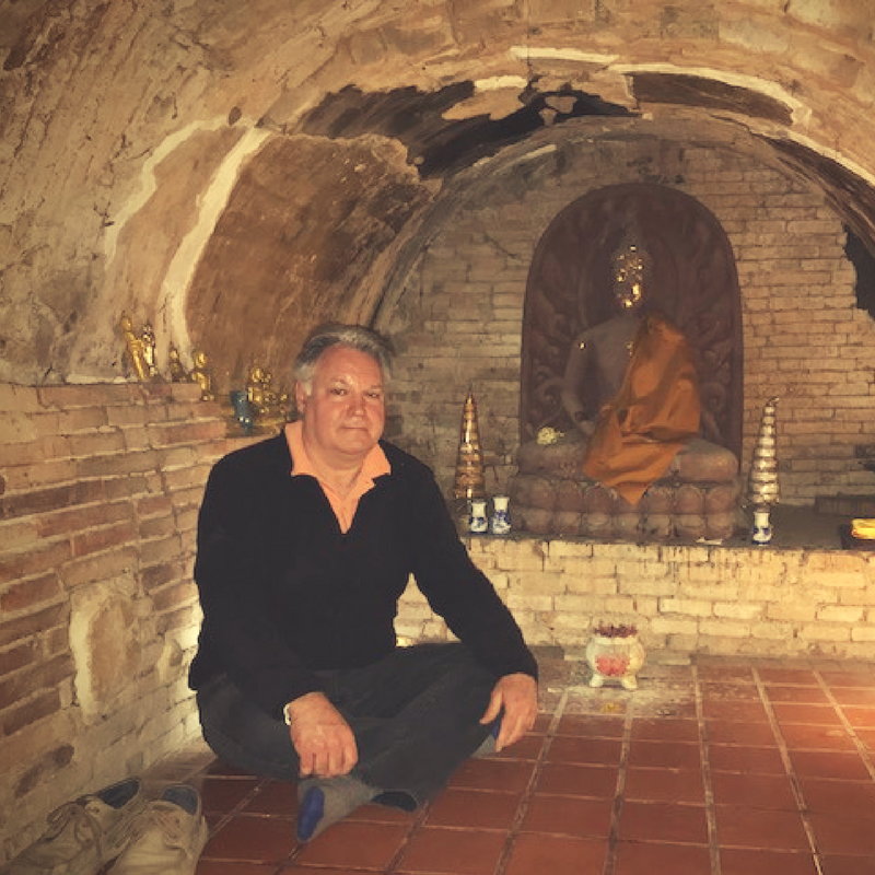 Bruce sitting in a meditation tunnel in Chiang Mai.