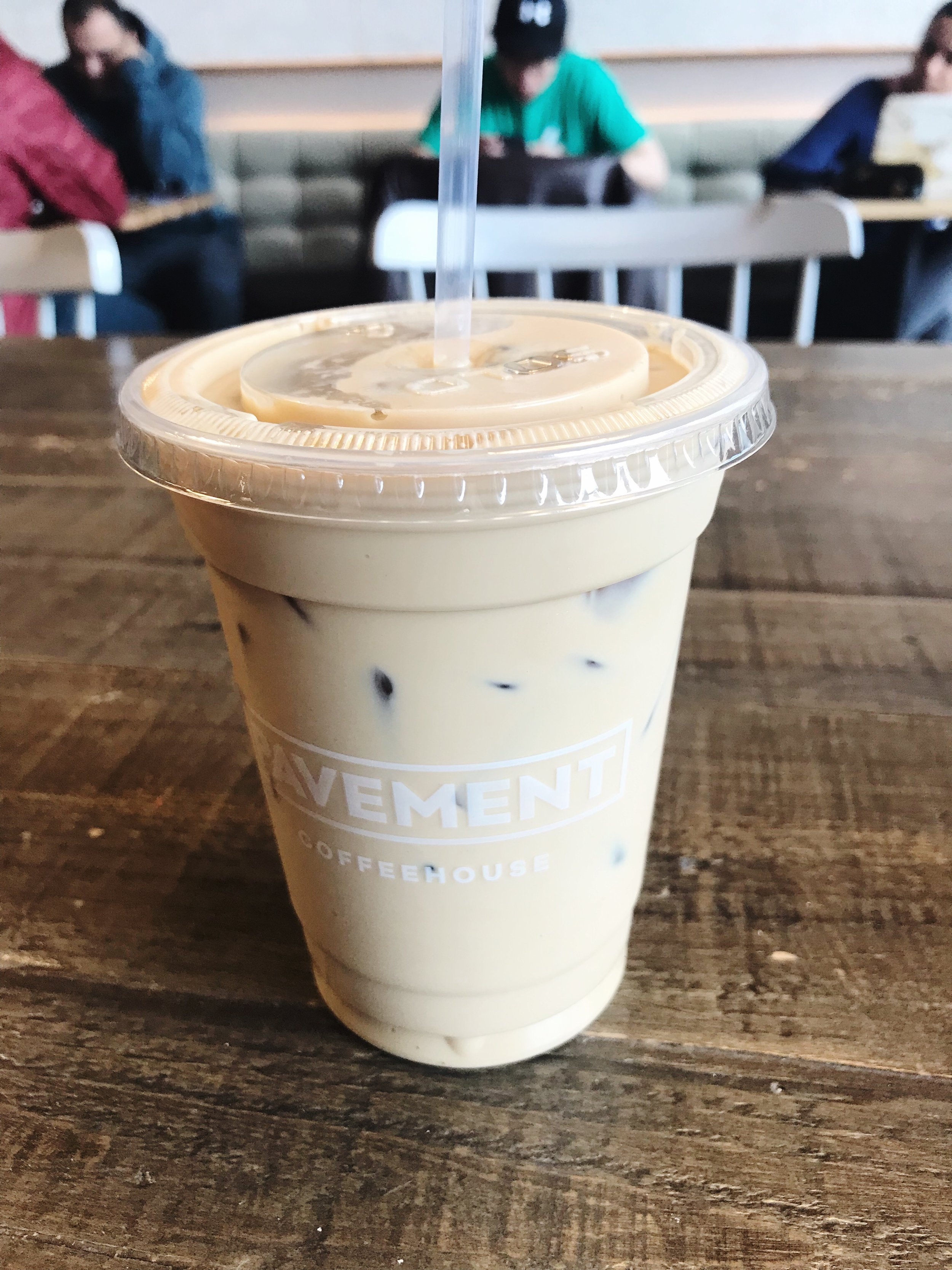 An iced latte at Pavement Coffeehouse