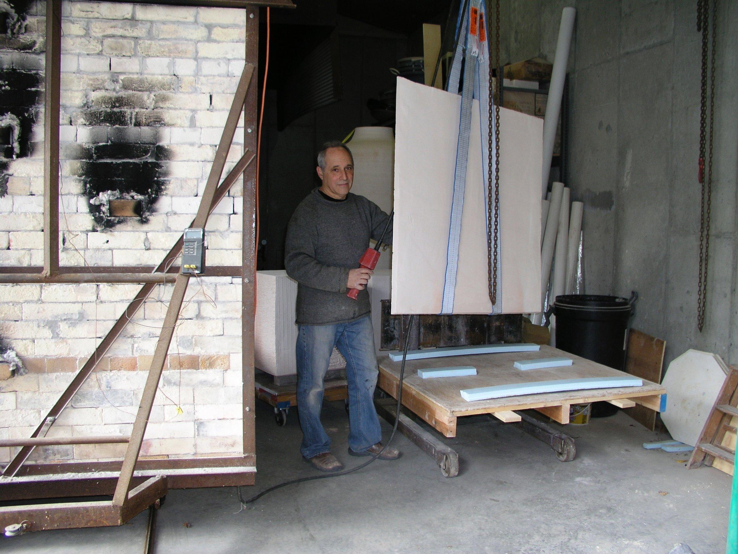 Loading tablet into kiln 2014.jpg