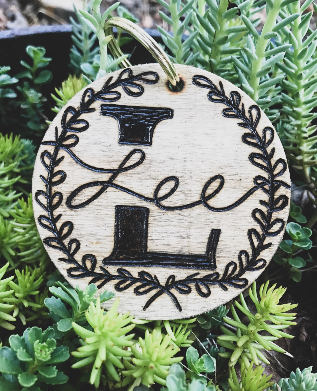 Custom Keychain - I can wood burn your last name initial, last name and the design around it. This keychain is 3