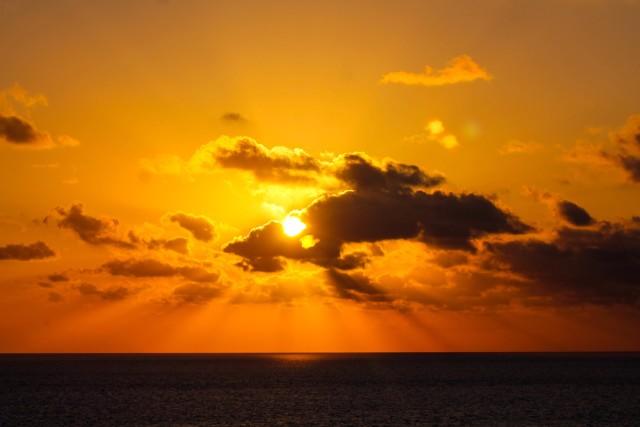 stock-photo-sunset-orange-ocean-cruise-cruise-ship-vacation-clouds-caribbean-sunrays-302f3608-c87d-4013-a555-15cdbbd885fa.jpg