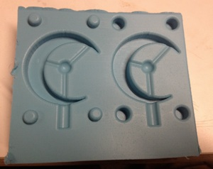 One part of a silicone mold used to form urethane parts.