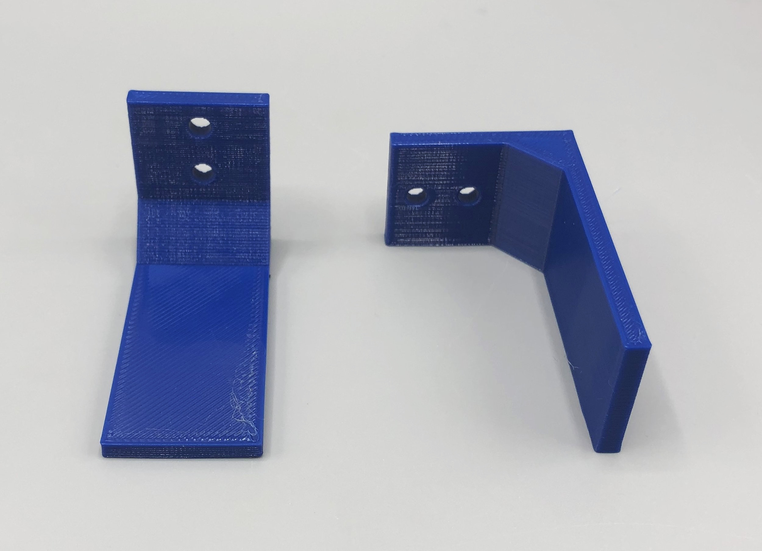 We printed the same shelf bracket in two different orientations. Which of these do you think will perform better?
