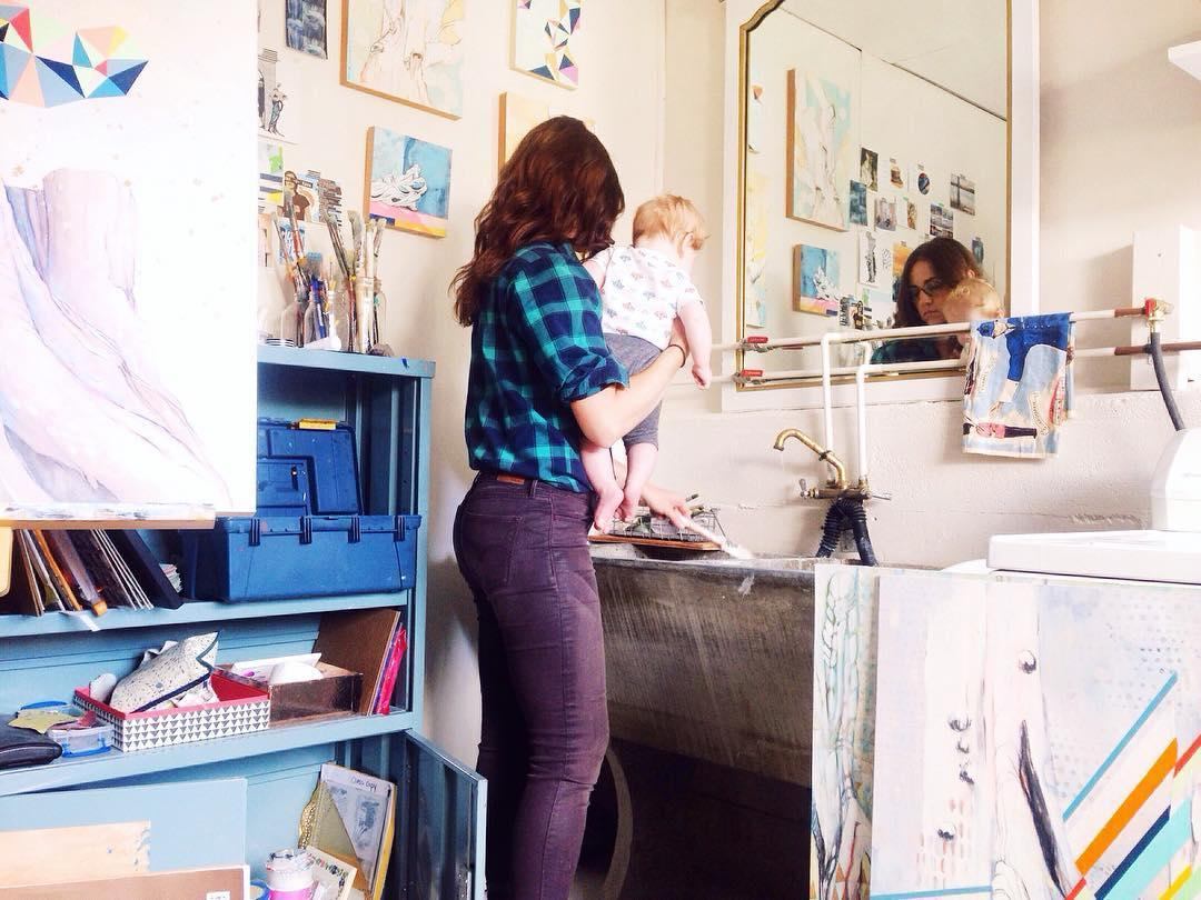 Denise in her studio with one of her sons.