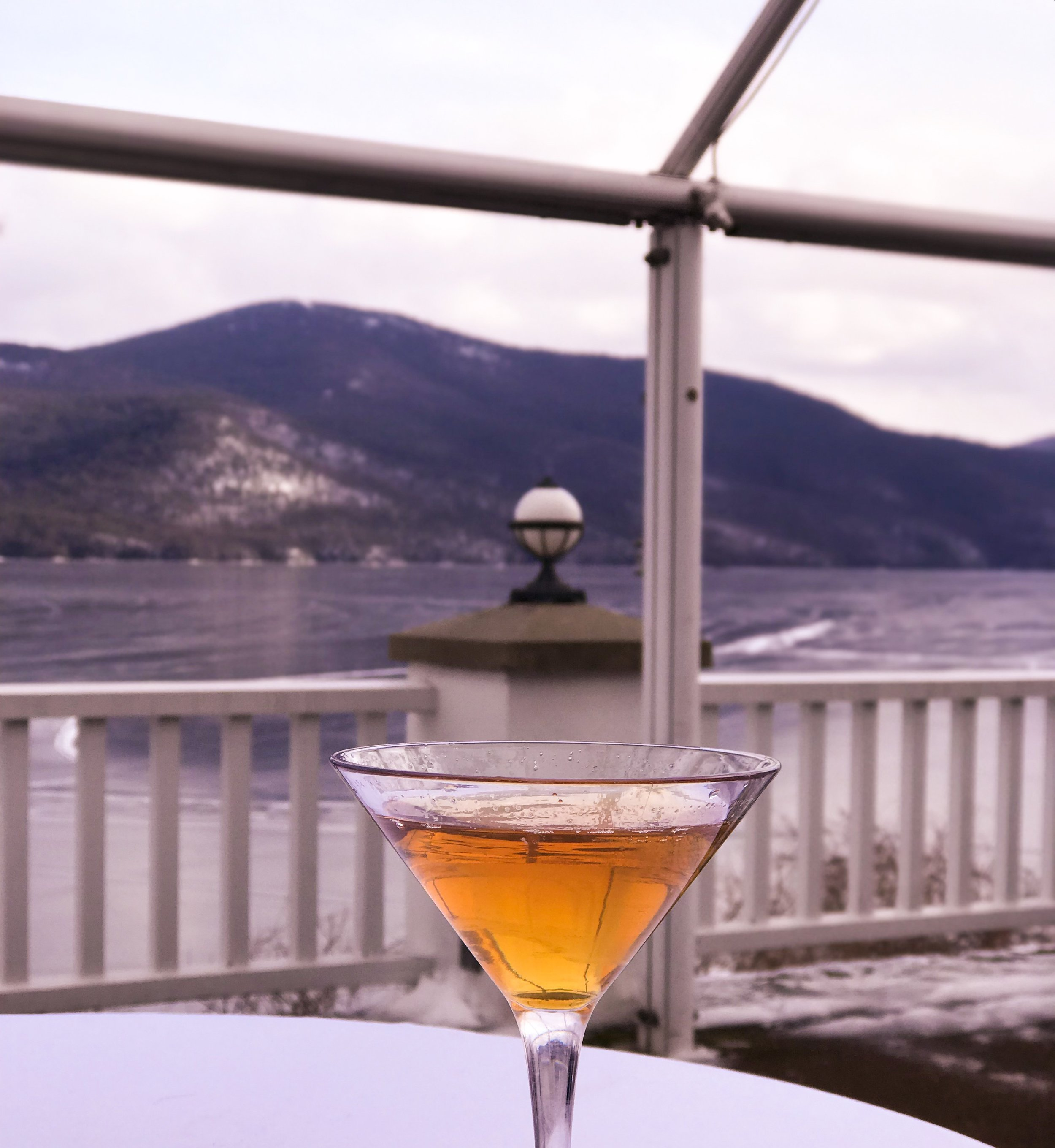 Nor'easter cocktail, with frozen Lake George as a backdrop.