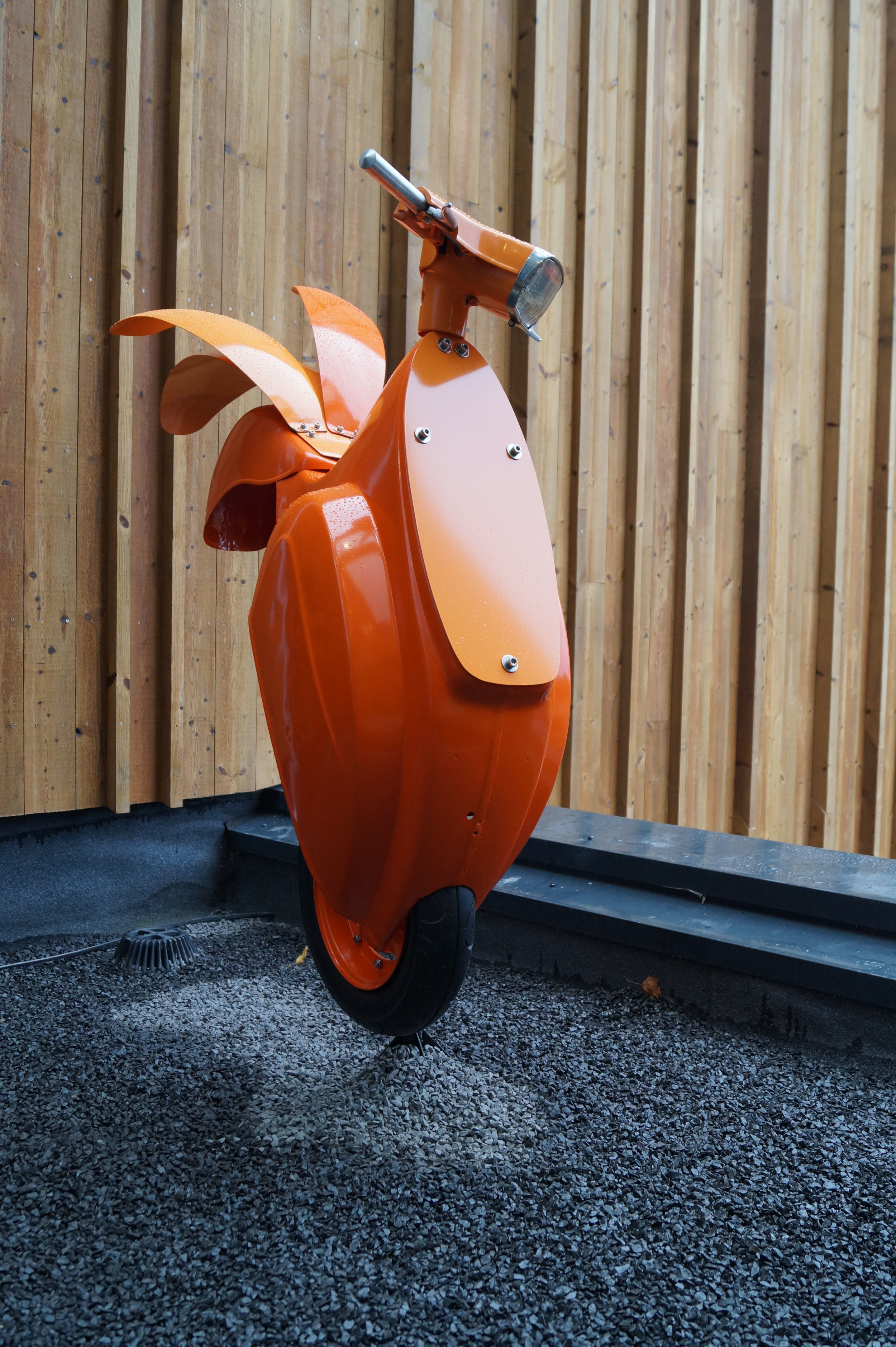 Outdoor sculpture made out of an old Vespa.