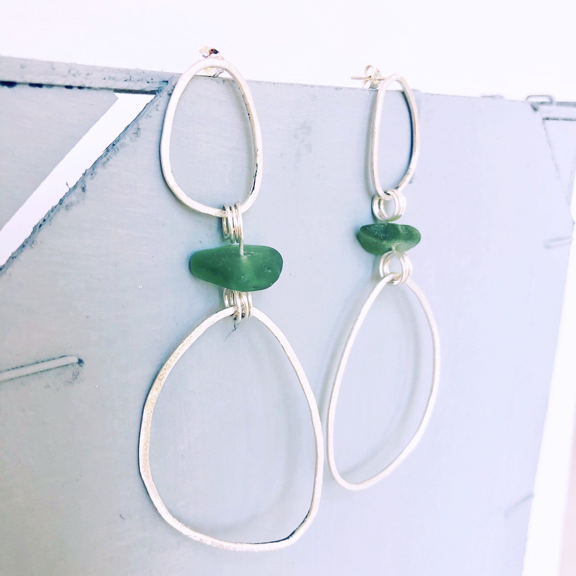 dangling seaglass earrings - • stunning long dangling earrings• sterling silver with a brushed finish• genuine green sea glass from France• SGED3120 Euro